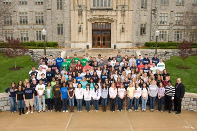 Group of fraternity and sorority members gathered on the steps of Burruss Hall