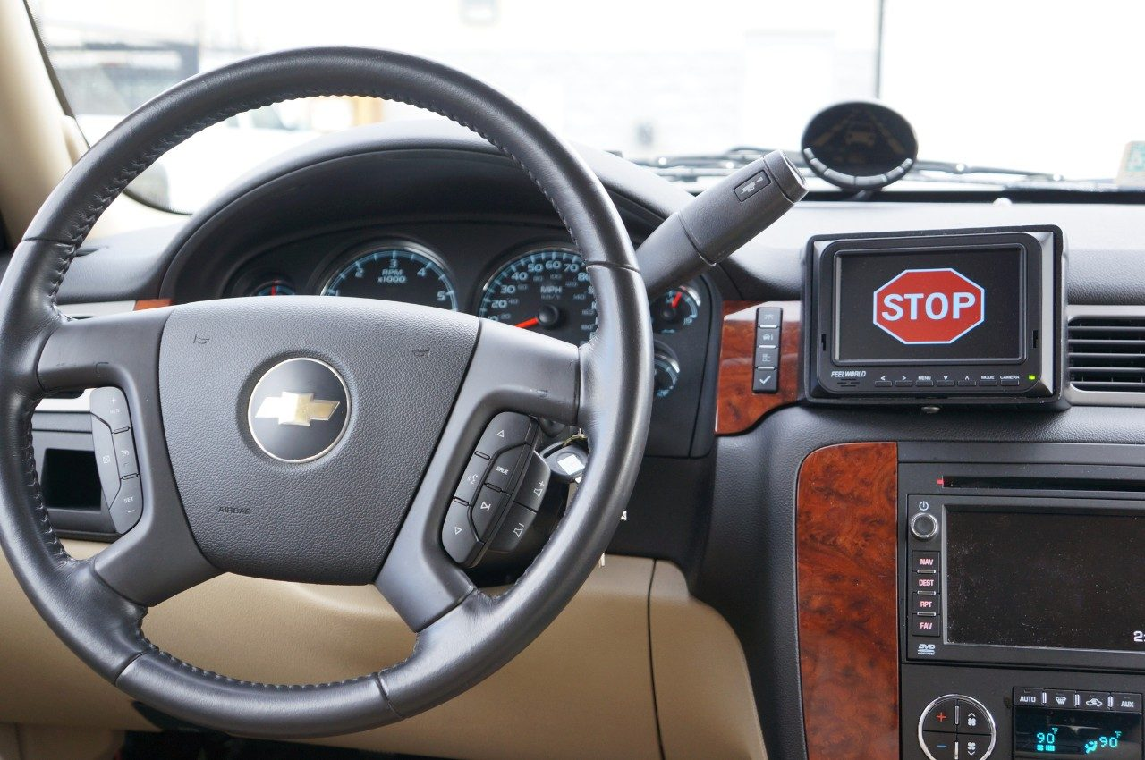 During the Adaptive Stop Yield Study, participants saw a stop sign display on their dashboard as part of traffic instruction, as well as a yield sign. The study seeks to bring traffic signs inside cars that use connected vehicle technology, rather than relying on physical posts signs that can be damaged, aged, or removed. The study, now in a proof of concept, was funded by the U.S. Department of Transportation.
