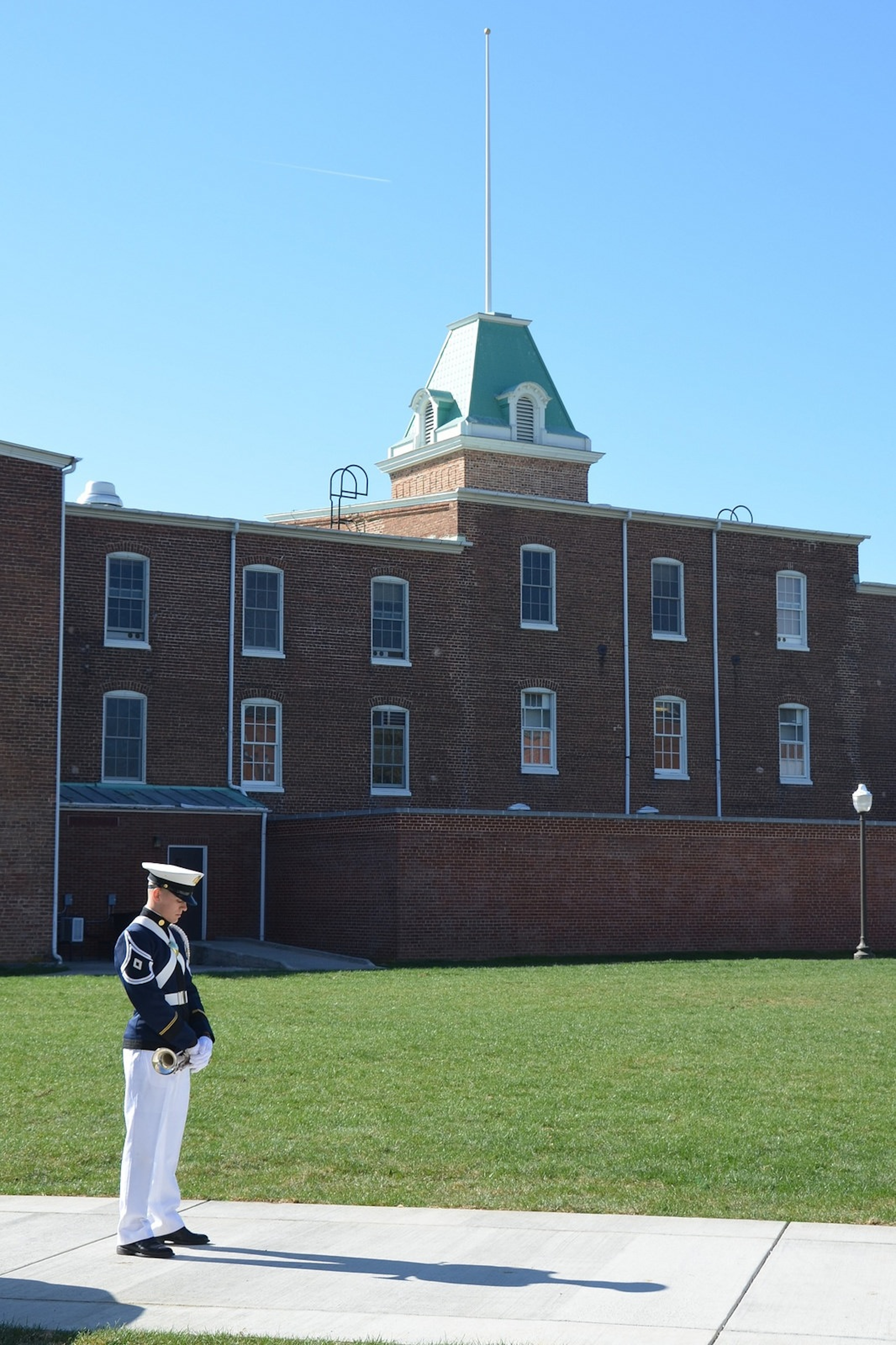 A bugler from the Virginia Tech Corps of Cadets stands ready behind Lane Hall to perform Echo Taps