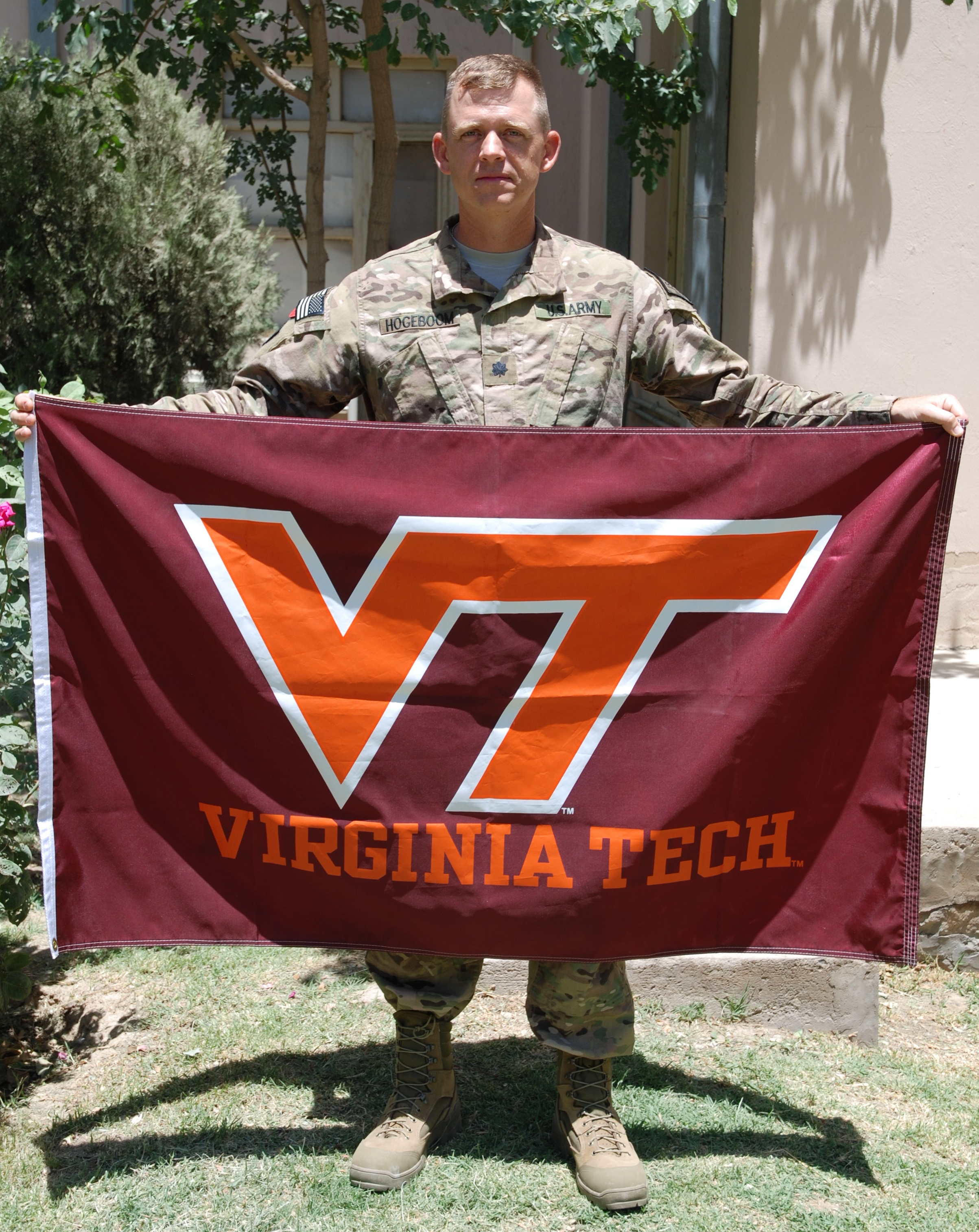 Lt. Col. Patrick Hogeboom, U.S. Army, Virginia Tech Corps of Cadets Class of 1994 holding the VT flag