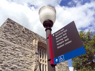 New navigation sign outside of Pamplin Hall