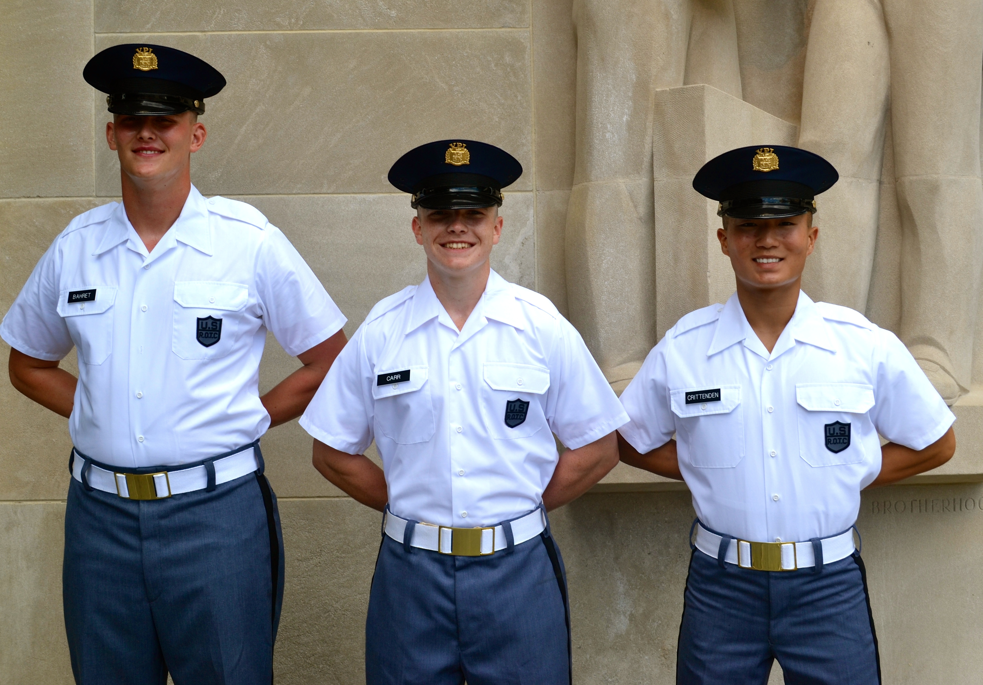 From left to right are Cadets Joseph Bahret, Christian Carr, and Sean Crittenden standing in front of the Pylons.