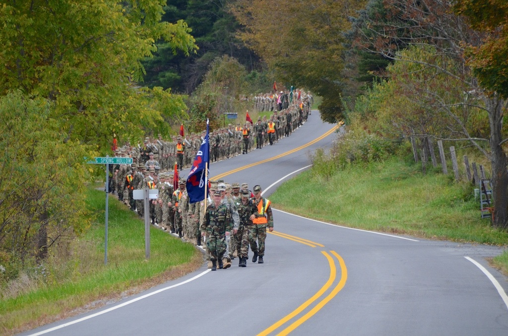 The Corps of Cadets march up a road during the 2013 Fall Caldwell March.