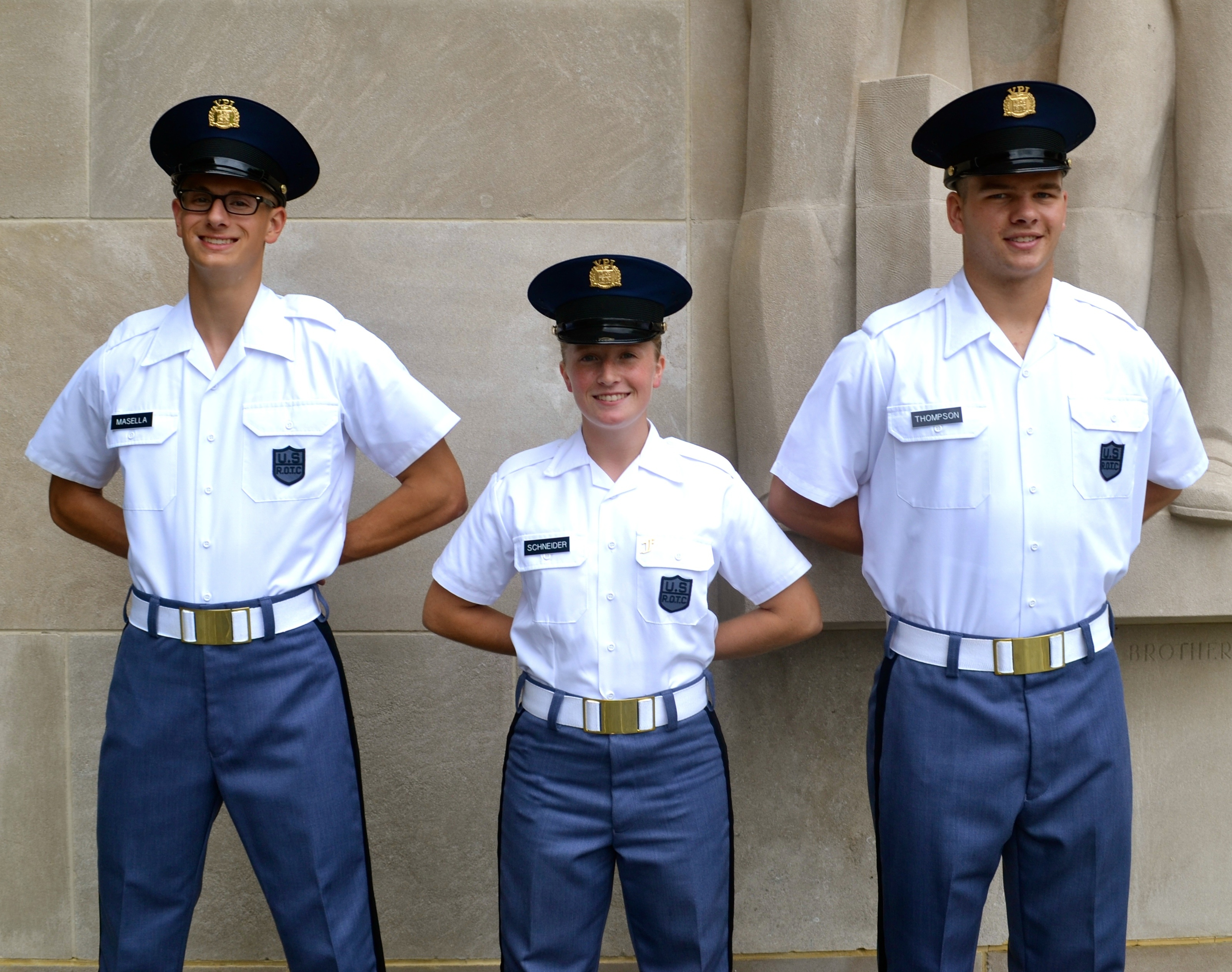 Standing in front of the Pylongs from left to right are Cadets Nicholas Masella, Robyn Schneider, and Matthew Thompson.