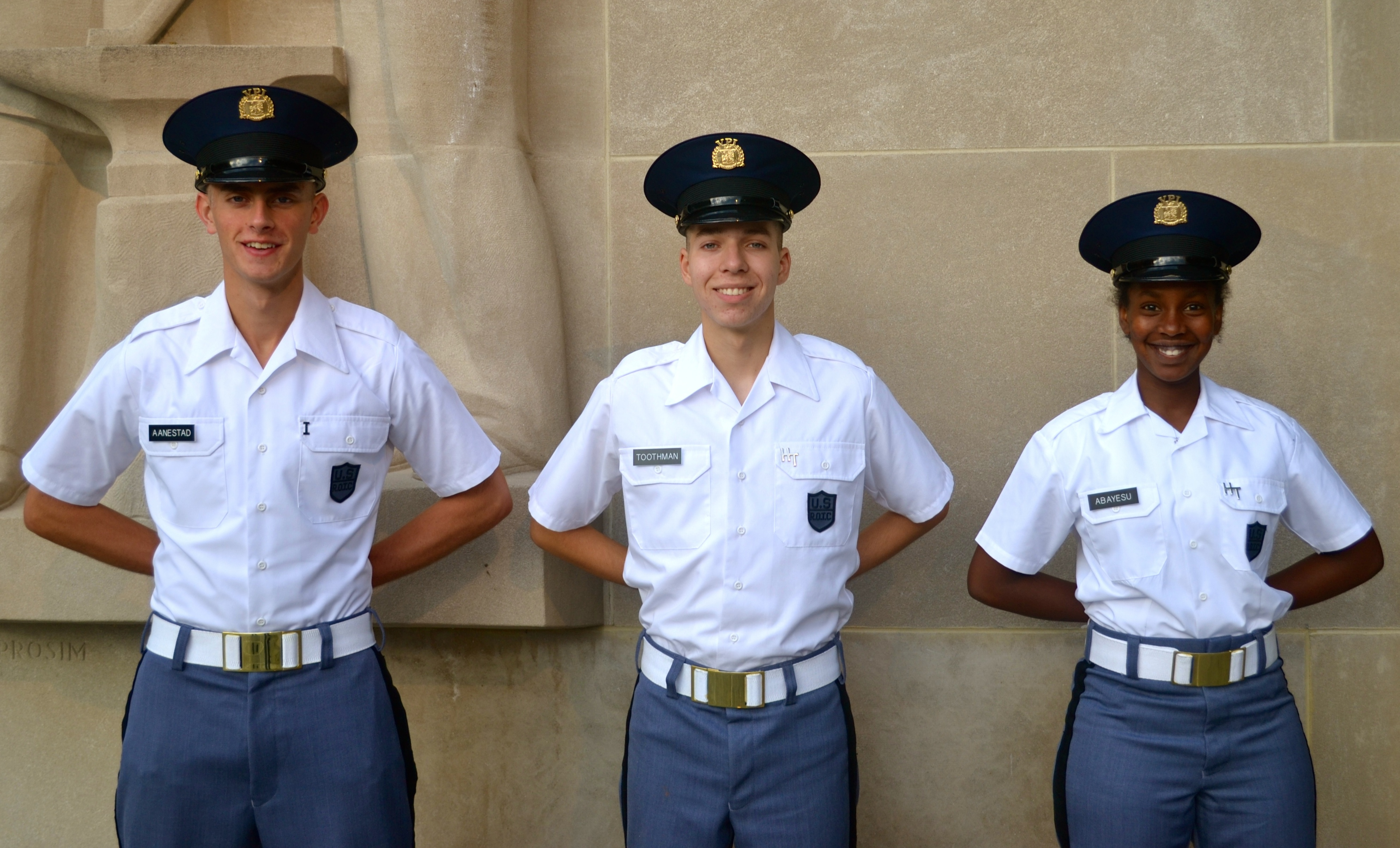 From left to right are Cadets Paul Aanestad, Zachary Toothman, and Precious Abayesu standing in front of the Pylons.