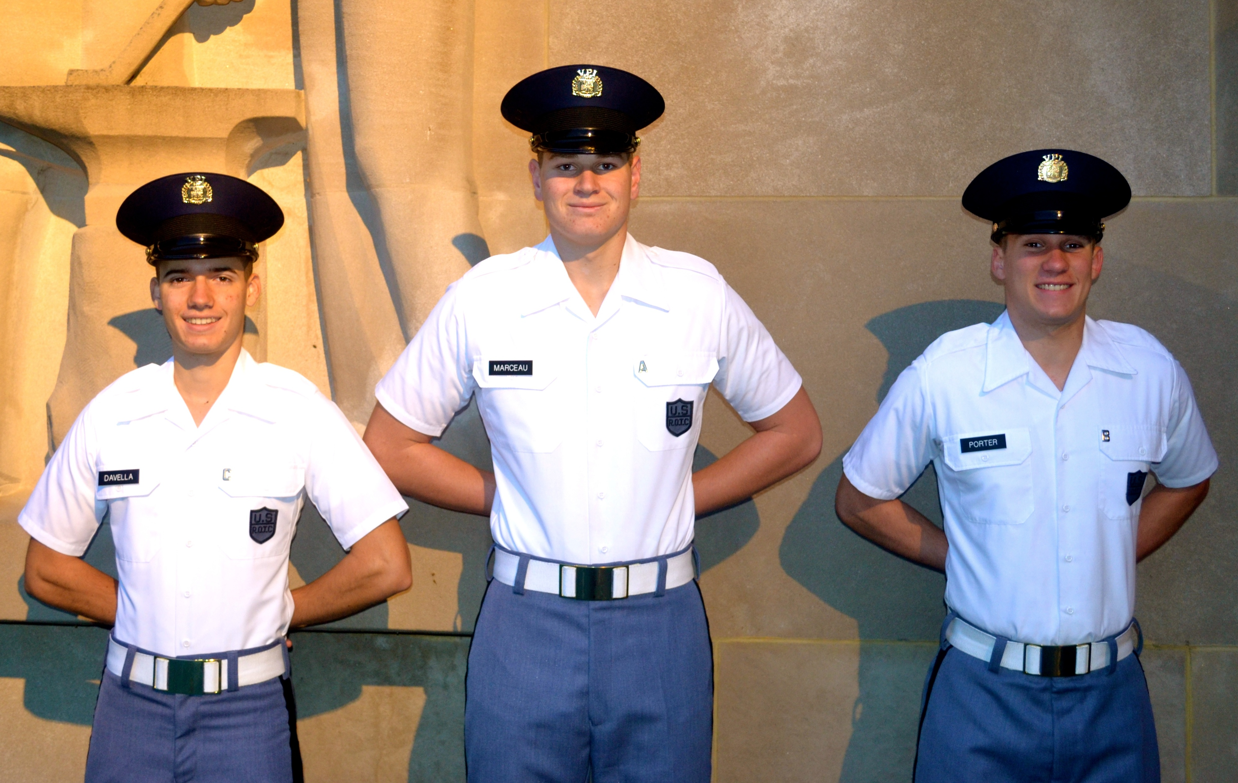 From left to right are Cadets Michael Davella, Bryan Marceau, and Joshua Porter standing in front of the Pylons.