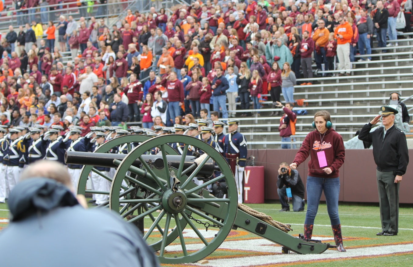 The Wounded Warrior Project raffle winner prepares to fire Skipper prior to the 2013 Virginia Tech versus Maryland football game.