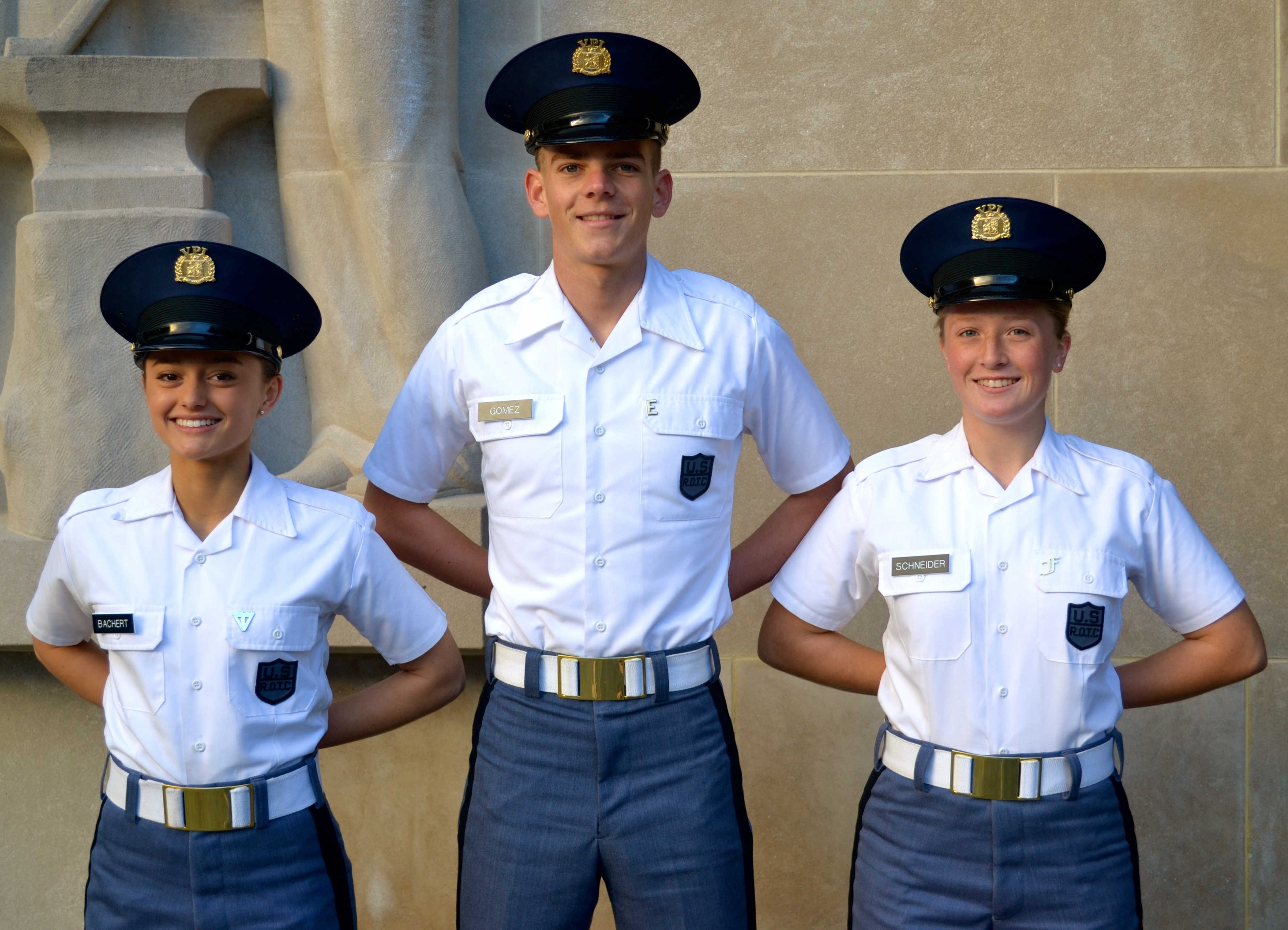 From left to right are Cadets Sabrina Bachert, Alex Gomez, and Robyn Schneider in front of the Pylons.