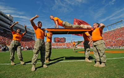 Esprit member does push ups on a board lifted in the air by other team members after a Hokie touchdown during the homecoming game this year.