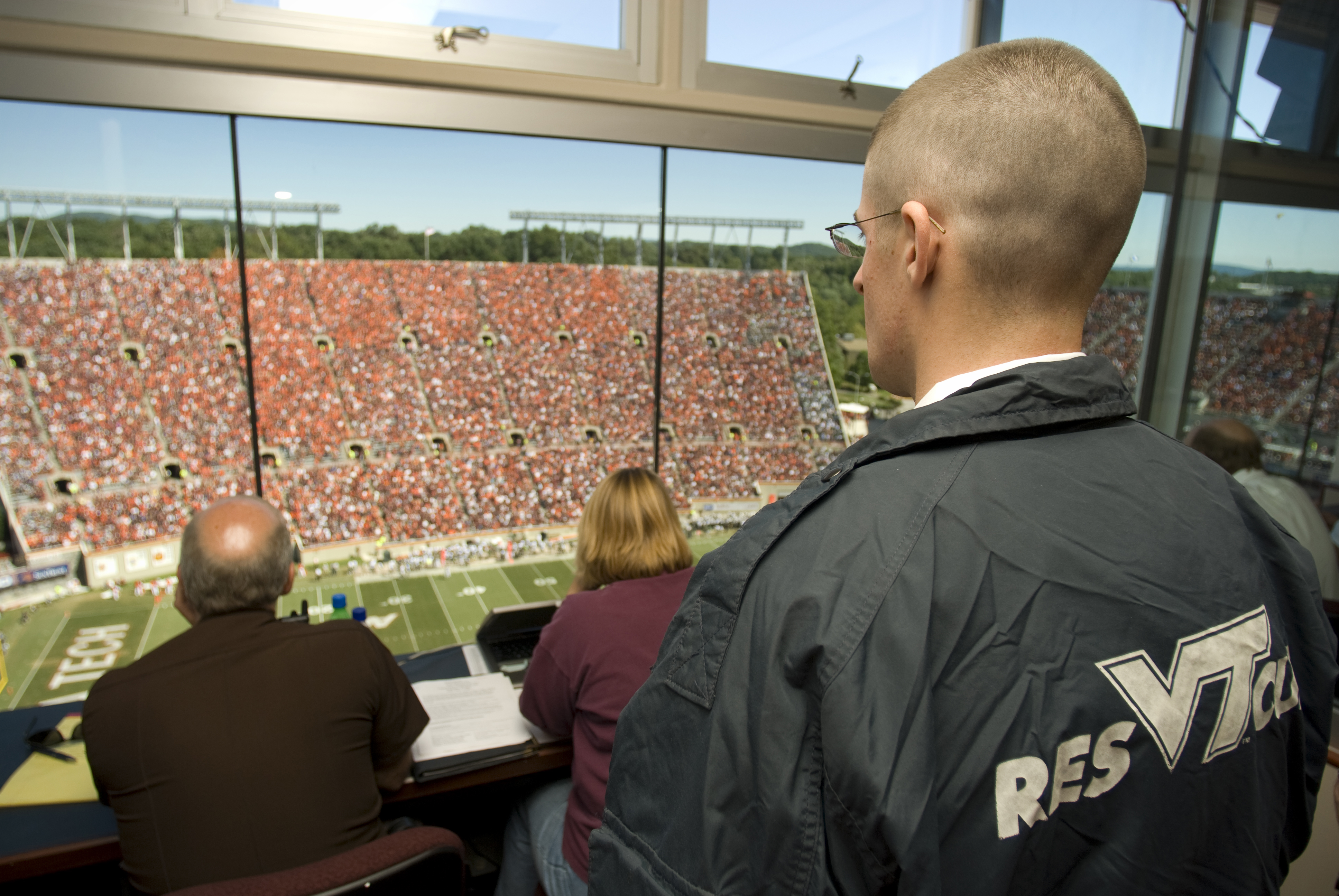 VT rescue squad personnel overlook the crowd at Lane Stadium during a home football game.