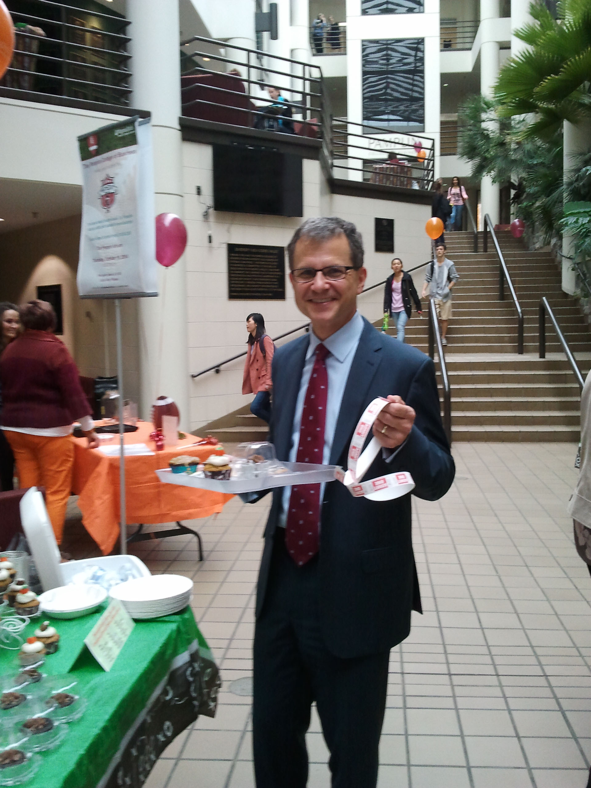 Pamplin dean Robert Sumichrast holds the tray of baked goods that he bought at one of the fundraisers the college's faculty and staff organized to support the CVC.