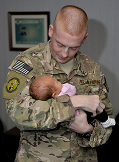 US Airman holding a baby.