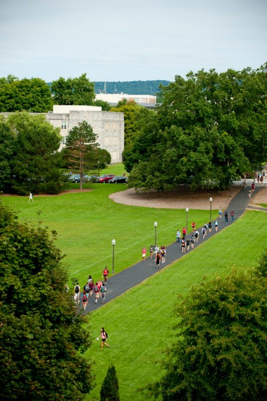 Students cross the Virginia Tech drillfield.