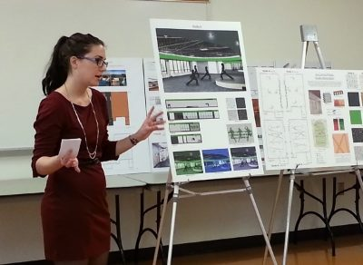 Young woman presents design boards for fitness studios.