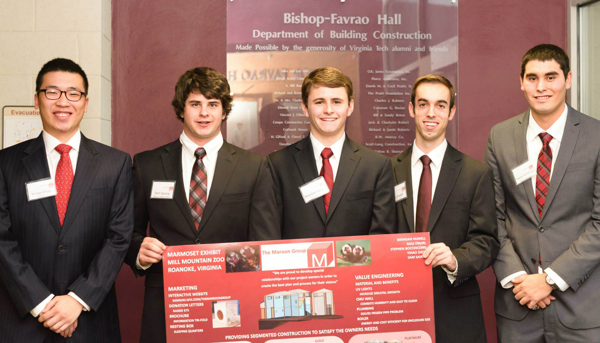 The five students on the winning team stand with their presentation board.