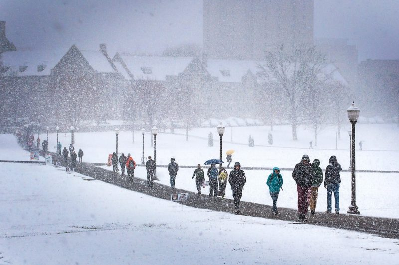 A snowy day for students walking to classes on the Drillfield.