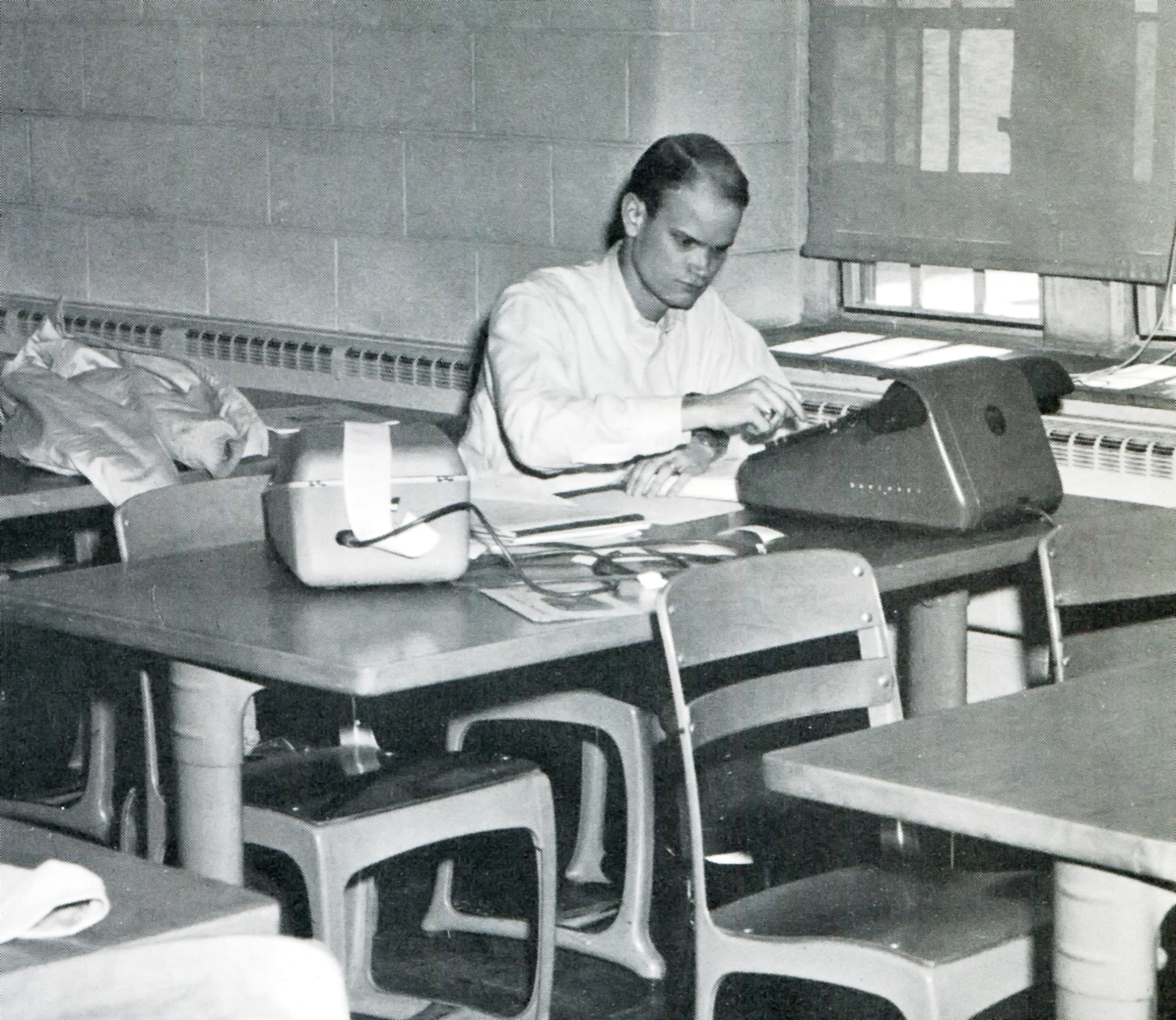 A business student at what was then Virginia Polytechnic Institute works on an assignment.