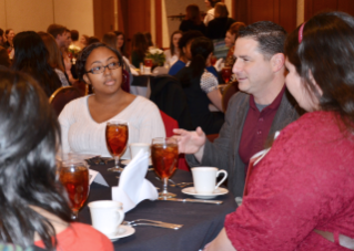 Doug Margulies (second from the right), a second-year student from Ashton, Maryland, speaks to prospective students at a dinner the day before the interviews.