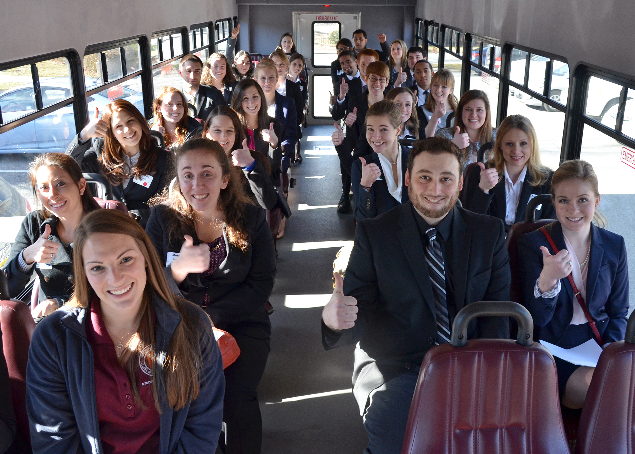 Candidates ride a shuttle bus to the Smith Career Center for interviews. They are accompanied by first-year veterinary student Bethany Cain (front row, left) of Morgantown, West Virginia.