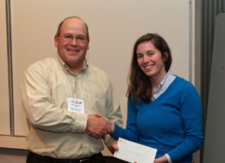 Alumnus John Copeland, left, a fisheries biologist with the Virginia Department of Game and Inland Fisheries, presents master's student Amanda Hyman with the Virginia Chapter of the American Fisheries Society's honorable mention scholarship award.