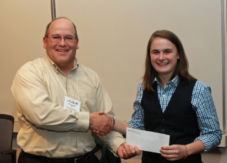 Alumnus John Copeland, left, a fisheries biologist with the Virginia Department of Game and Inland Fisheries, presents Erica Ascani, a junior majoring in fish conservation, with the Virginia Chapter of the American Fisheries Society's Jenkins Scholarship Award.