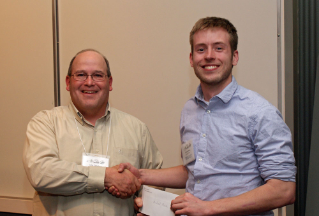 Alumnus John Copeland, left, a fisheries biologist with the Virginia Department of Game and Inland Fisheries, presents master's student Michael Moore with the Virginia Chapter of the American Fisheries Society's Ross Scholarship Award.