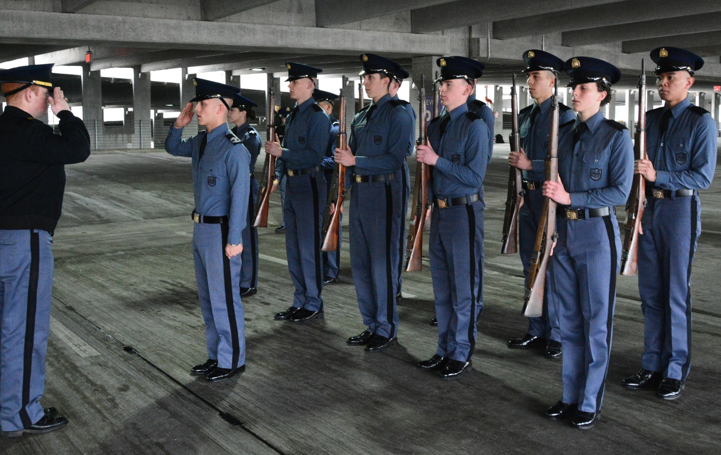 A cadet squad reports in as part of the Jaffe Eager Squad drill competition in the Turner Street parking garage.