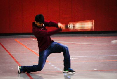 A player swings the cricket bat during practice in the gym.