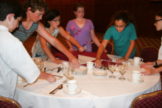 The 2014 Basic Culinary Camp participants showing off what they learned about dining etiquette.