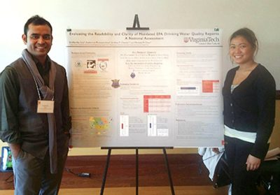 Students presenting at research symposium