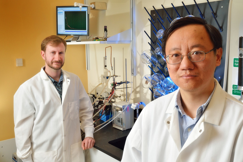 Virginia Tech professor Percival Zhang, at right, and recent doctoral graduate Joe Rollin.