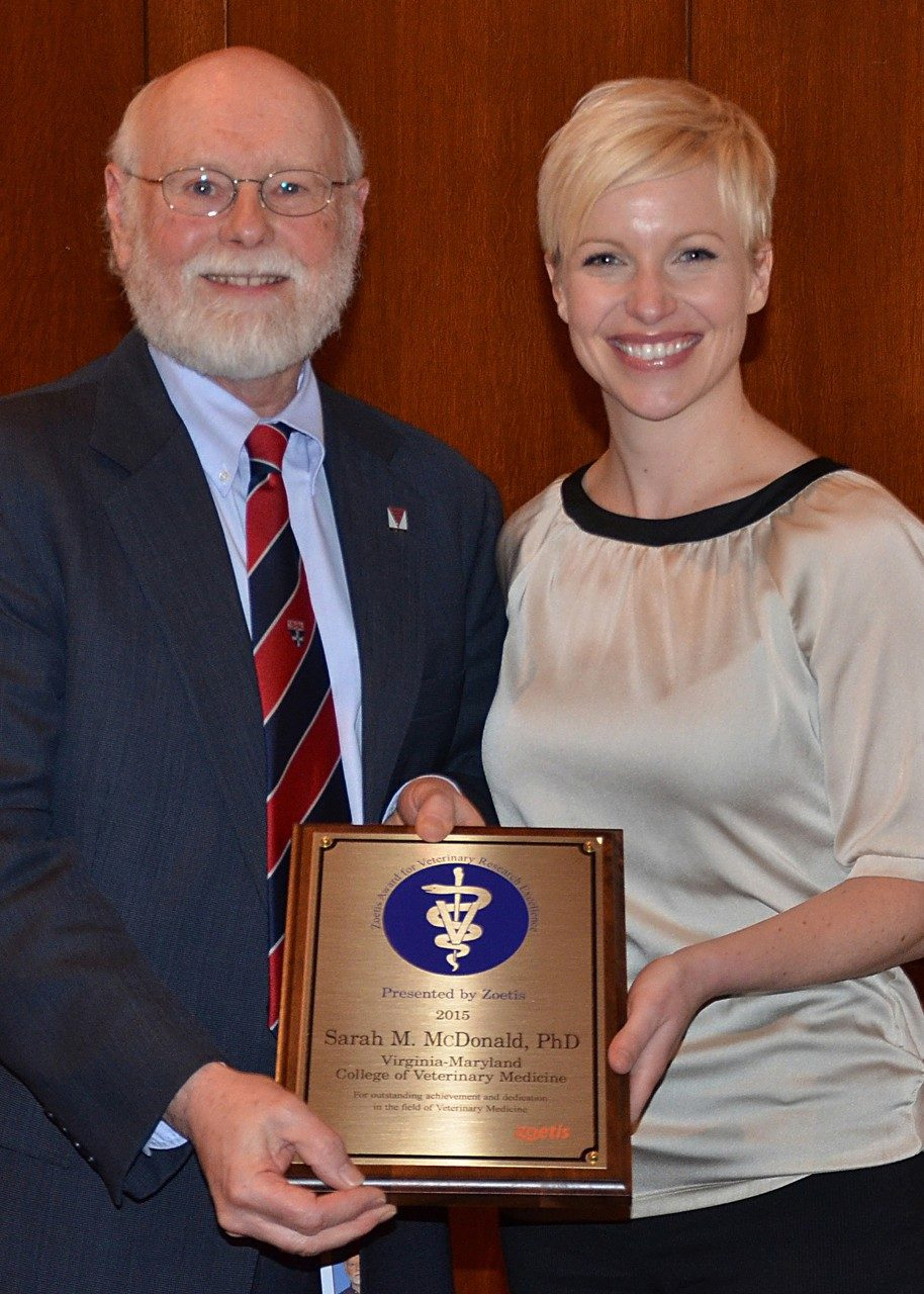 Roger Avery, senior associate dean for research and graduate studies, presents Sarah McDonald with the 2015 Zoetis Award for Research Excellence.
