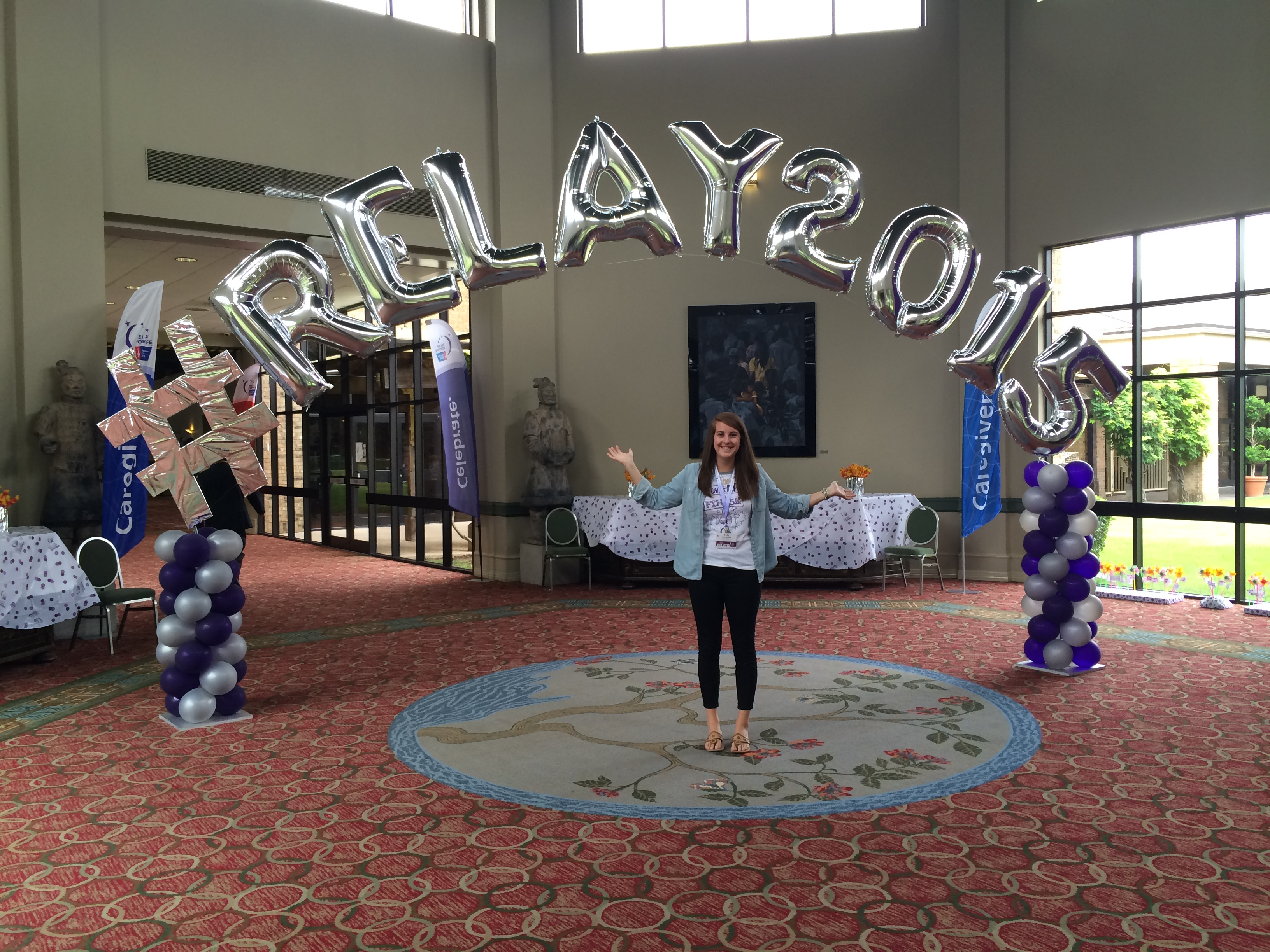 Emily McCloud, director of Relay For Life at Virginia Tech, poses with balloons that spell out #RELAY 2015.