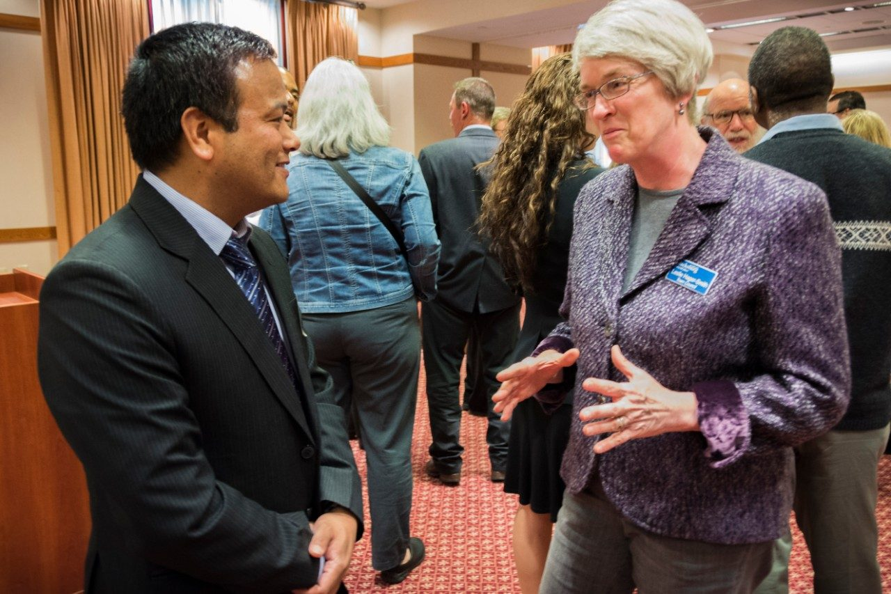 Khim Ghale, a journalist from Nepal, talks with Blacksburg Councilwoman Leslie Hager-Smith during a reception for the Humphrey Fellows at The Inn at Virginia Tech and Skelton Conference Center.