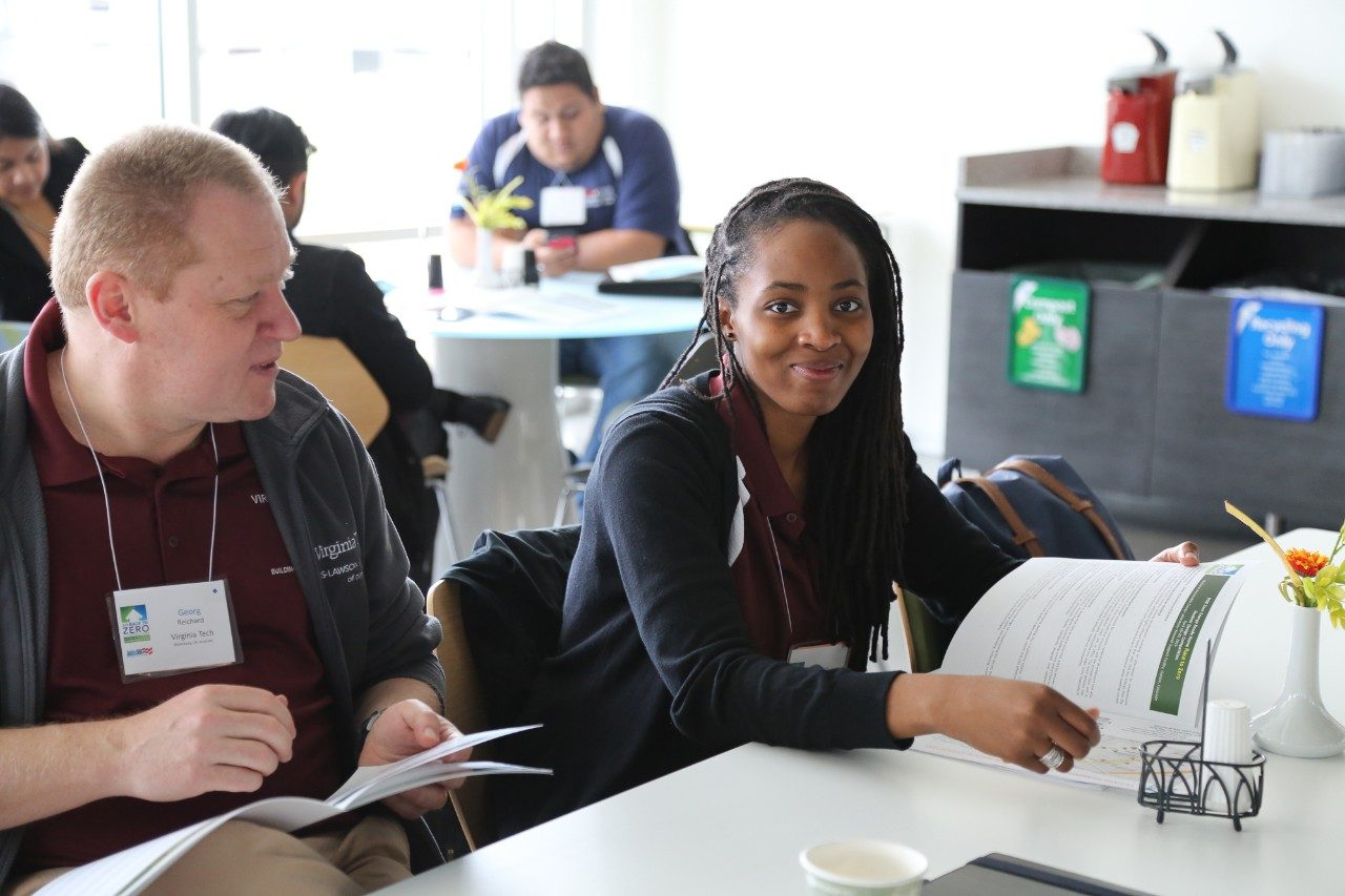 Virginia Tech's Georg Reichard, an associate professor of building construction, and project lead developer Teni Ladipo during a break in the competition.