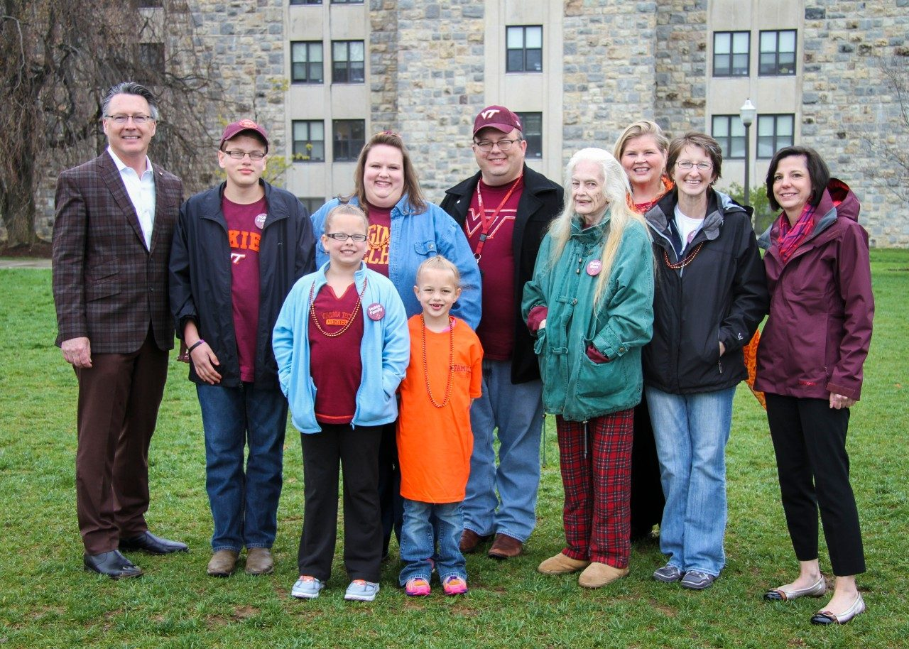 Celebrating Spring Family Weekend with the Cherry family, Virginia Tech 2015 Family of the Year. (Back row from left) President Timothy D. Sands, Bruce Cherry, LuAnn Chery, Earl Cherry, Vice President for Student Affairs Patty Perillo, Kathy Botkin, Laura P. Sands. (Front row) Lucy Kate Cherry, Emeline Cherry, and Rachel Cherry.