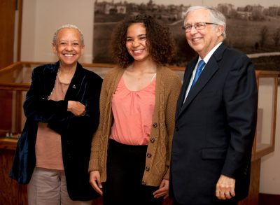 Michelle Wright (center), who won third place in the 2015 Steger Poetry contest, is pictured with Nikki Giovanni and Charles Steger.