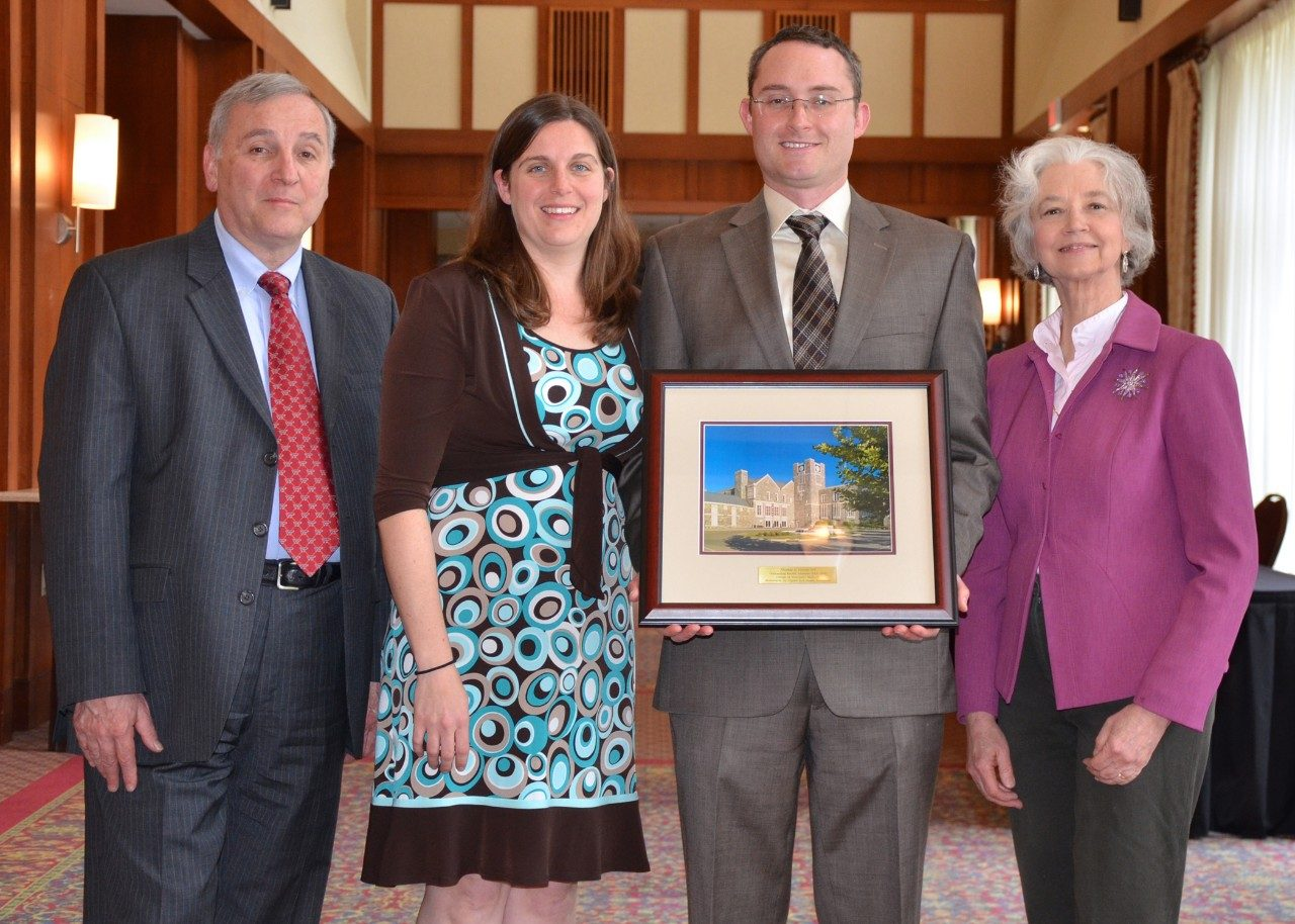 Dr. Tom Cecere, third from left, is joined by parents, Tom and Cheryl Cecere, and wife, Dr. Julie Cecere, at the spring awards luncheon.