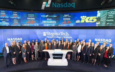 President Sands, Dean Sumichrast, and various Pamplin alumni, members of the Pamplin Advisory Council, students, and college representatives posed at the Nasdaq MarketSite broadcasting studio.