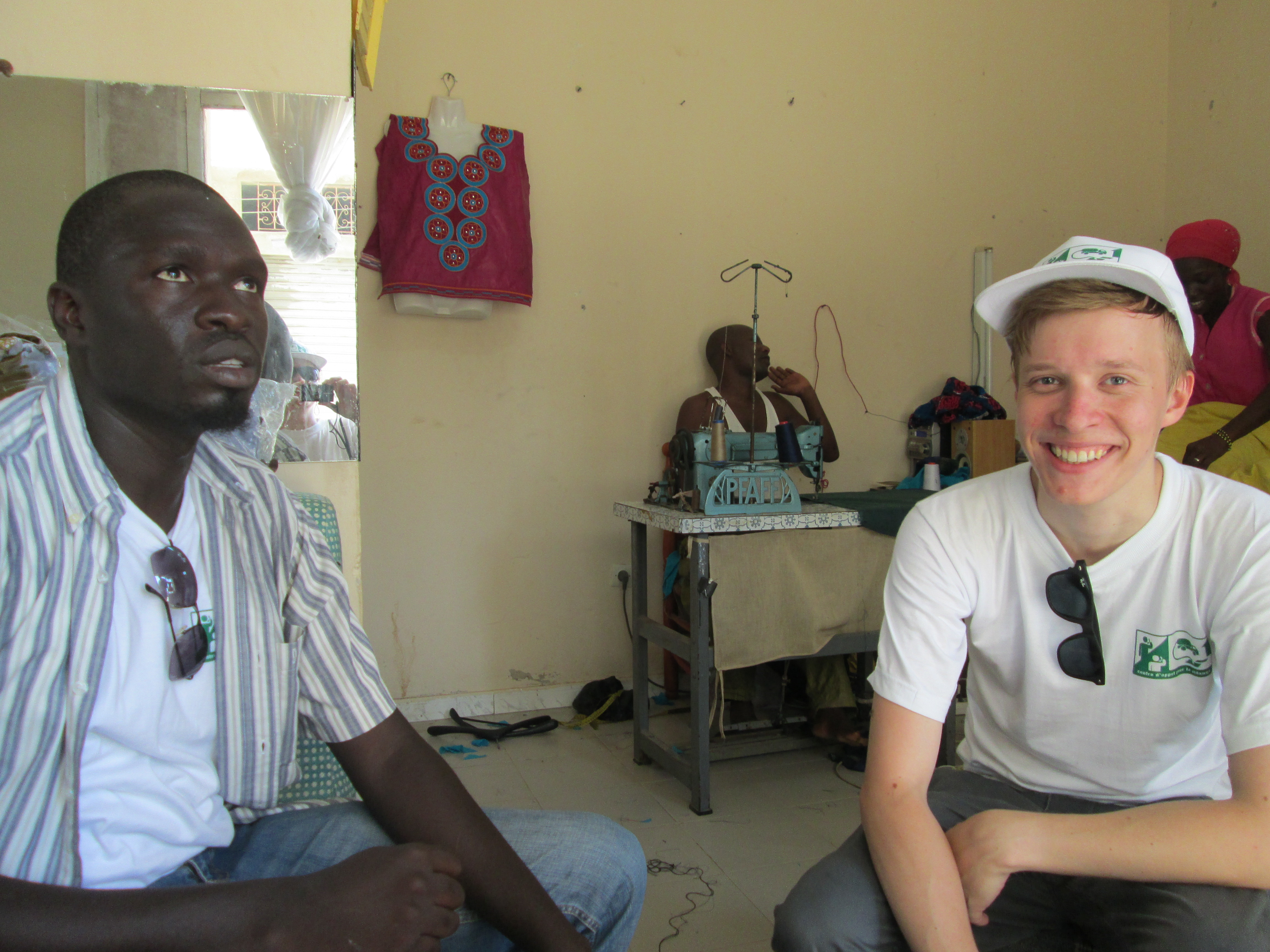 Joshua Deutschman with residents of a Dakar, Senegal neighborhood