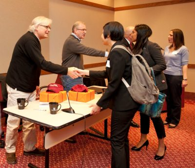 Pamplin students thank Doug Curling (far left), Phil Bullock, and Jim Hatch after the presentation.