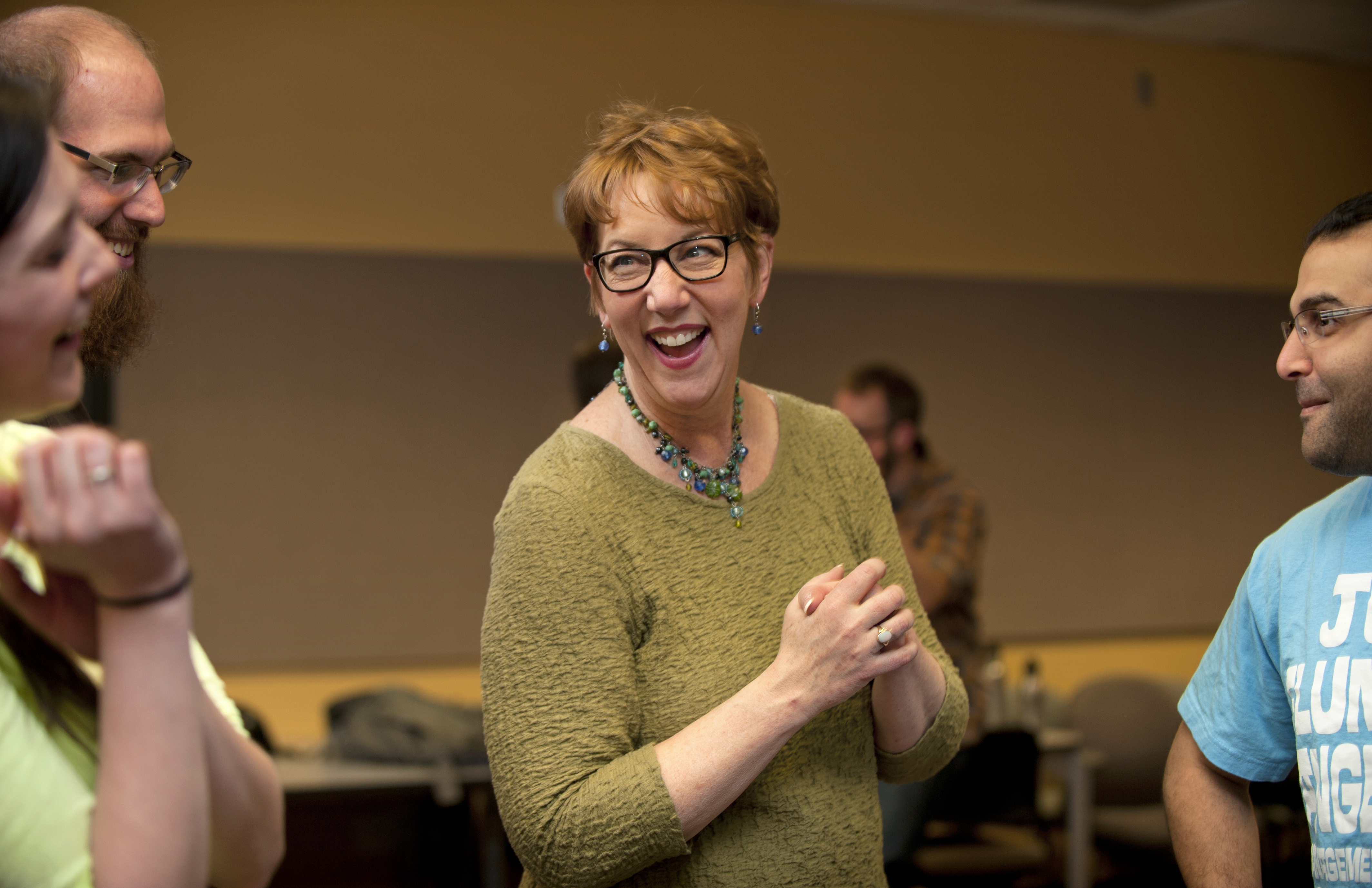 Patricia Raun laughs with students during her Communicating Science class.