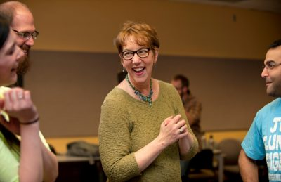 School of Performing Arts Director and Communicating Science instructor Patricia Raun laughs with students during a recent session of the class.