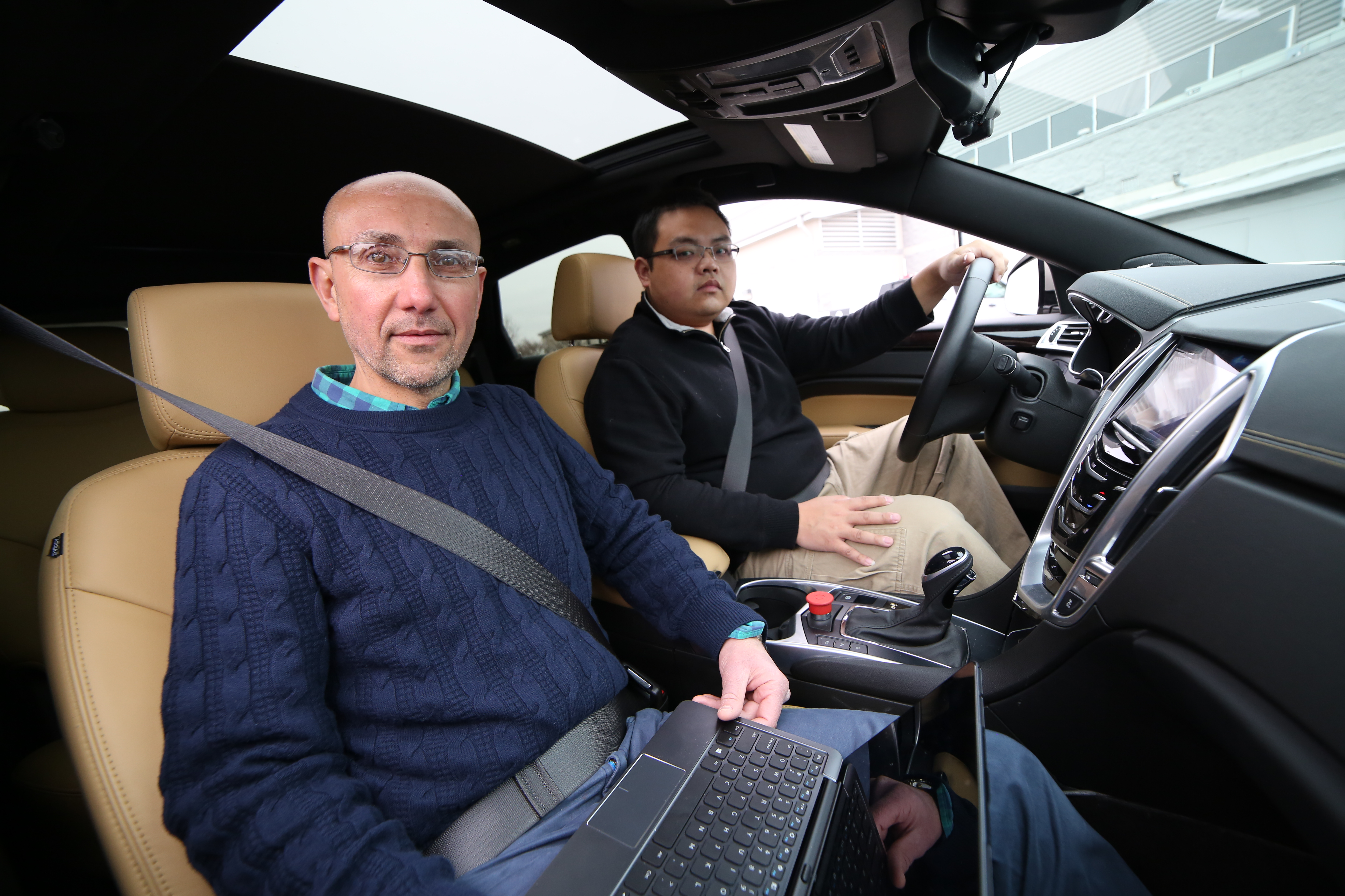 Hesham Rakha, at left, and Hao Chen sit in a test vehicle