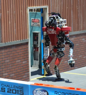 On the first competition day of the DARPA Robotics Challenge, Team ViGIR's Atlas robot Florian successfully opened a door and walked through the threshold, and also turned a valve.