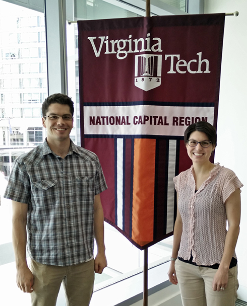 Will Walters and Katherine Royston standing in front of National Capital Region banner
