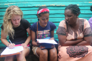 In Madagascar, SURF student Keely O'Keefe, at left, worked with translators such as Jumelle Tsifanay, at center, to communicate with local people about their diets. Photo by Hailey Boone.