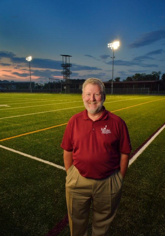Dave McKee standing on new field for Marching Virginians