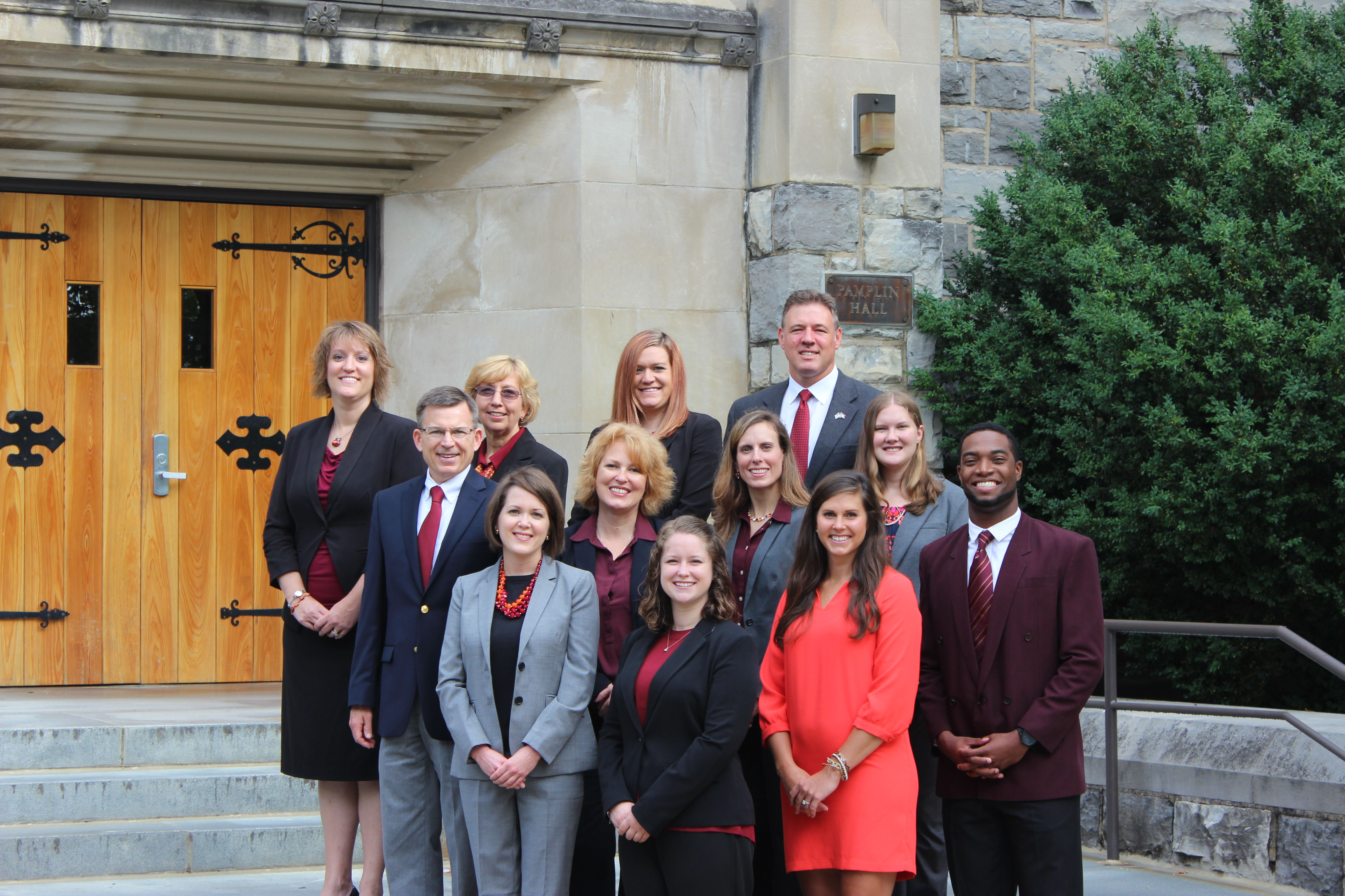 The Pamplin academic advising team pose outside Pamplin Hall. (L to R) Back Row: Leigh Anne Byrd, Lorraine Borny, Lindsey Ramey, Justin Monday; Middle Row: Keith Gay, Jennifer Clevenger, Kirsten Mosby, Christina Minford; Front Row: Kelley Ausman, Alison Wade, Katie Wells, Lorenzo Williams