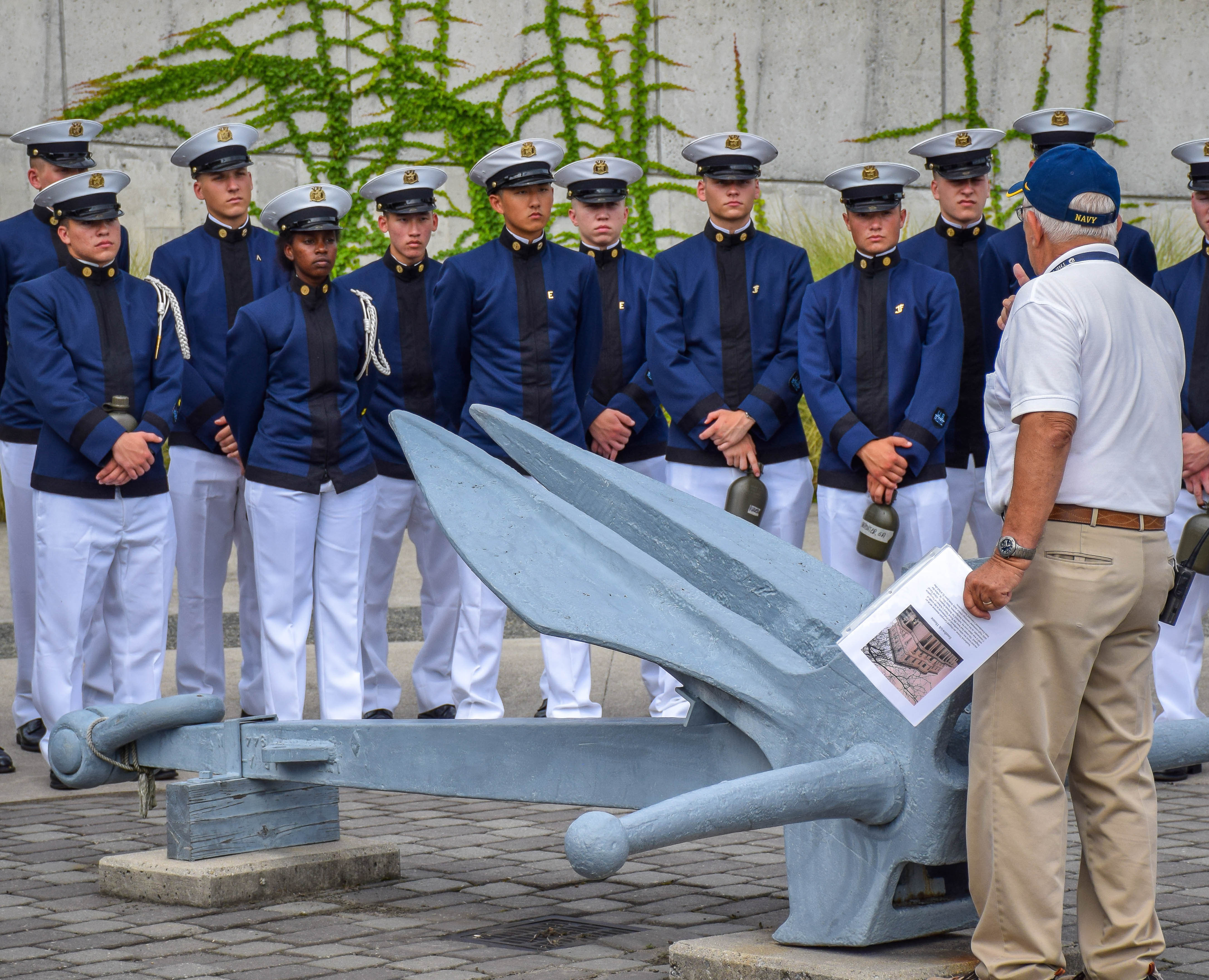 Cadets visiting the National D-Day Memorial in Bedford, Va. listening to a veteran speak